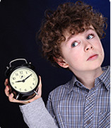 kid with alarm clock